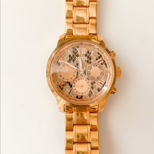 Guess gold watch never worn still have links